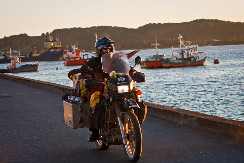 Craig on a KLR headed for Ushuala in Terra del Fuego.<br /> Quellón harbor, Chiloé Island.