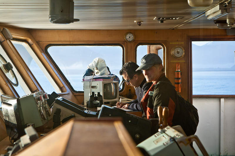 The captain was very lenient about people entering the bridge. Craig looking on. Approaching Patagonia mainland.