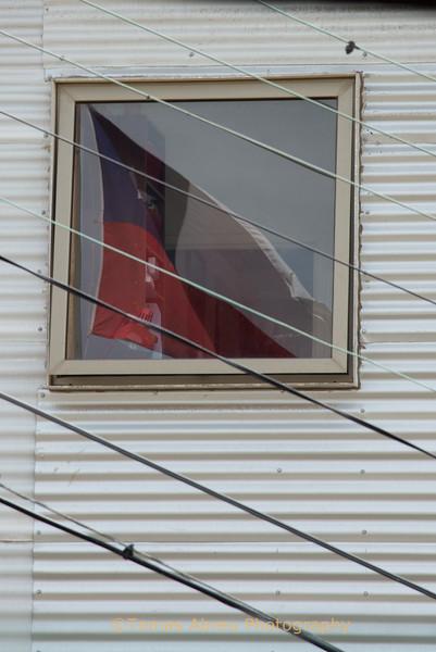 Chilean flag reflection on window, Valparaiso