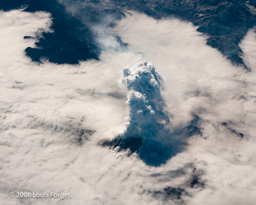 Volcano Erupting through the Clouds