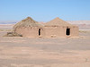 Reconstructed dwellings at Tulor, a 2800 year-old village in the desert.