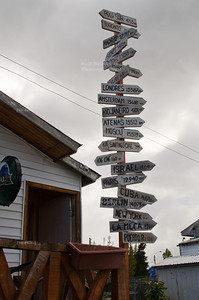 A sign post along the road between Punta Arenas and Puerto Natales on the Chilean side of southern Patagonia indicating the distance to many places around the workd