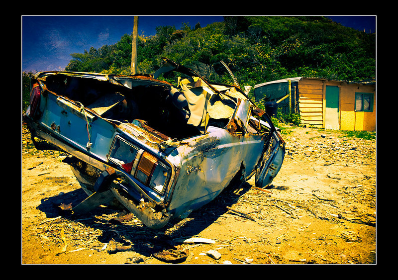 A car, brutally violated and abandoned by the mighty sea.