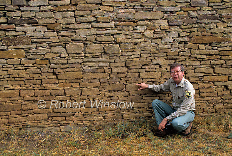 Forest Service Employee Shows off original Rock Wall of Ancestral Pueblo Structure, Chimney Rock Archaeological Area and National Historic Site, San Juan National Forest, Archuleta County, Colorado