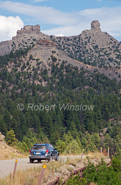 Automobile leaving, Chimney Rock Archaeological Area and National Historic Site, San Juan National Forest, Archuleta County, Colorado, Rock Pillars in distance, property release on automobile