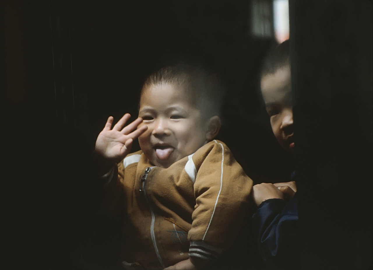 From a train window on the way from Hong Kong to Guangzhou.  The two trains met and slowed and this shot presented itself between the two windows.  Sorry about the window glare.