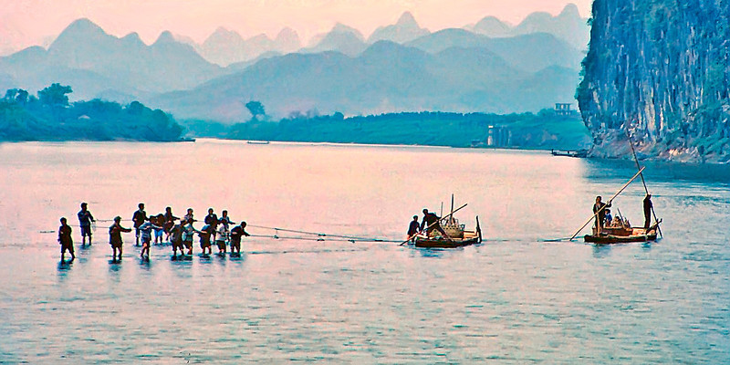 Pulling rice barges on the Li River