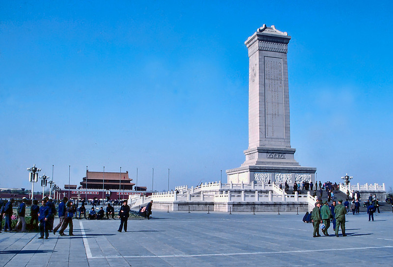 "Tian'anmen Square, the Monument to the People's Heroes was built in 1949 in memory of ""martyrs who lost their lives for Chinese revolutionary struggles"". Entrance to the Forbidden City in the background."