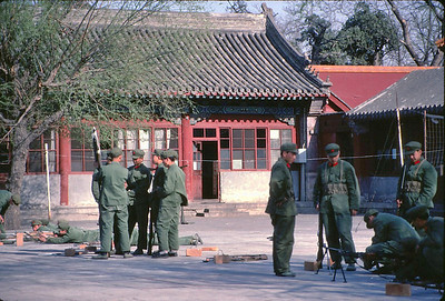 In one of the many courtyards in the Forbidden City.  Disconcerting to see simulated firing practice in a tourist center.  I was lucky to get this shot as I had to hold the camera to my hip and hope for the best.  To shoot any military activity in the open risked camera confiscation or worse.