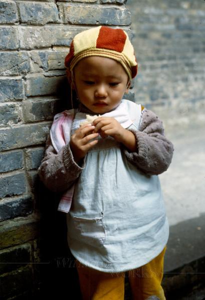 Little boy near the nursery school on our campus in Nanchong