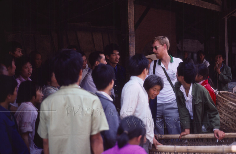 Chris Wilde with a crowd at the Nanchong market