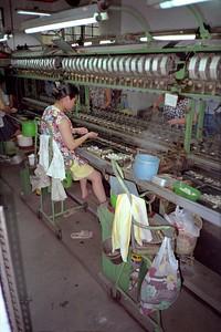 Cocon machinaal afwikkelen