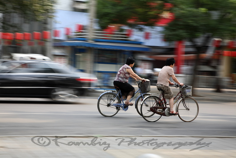 women riding bicycles in Beijing, china