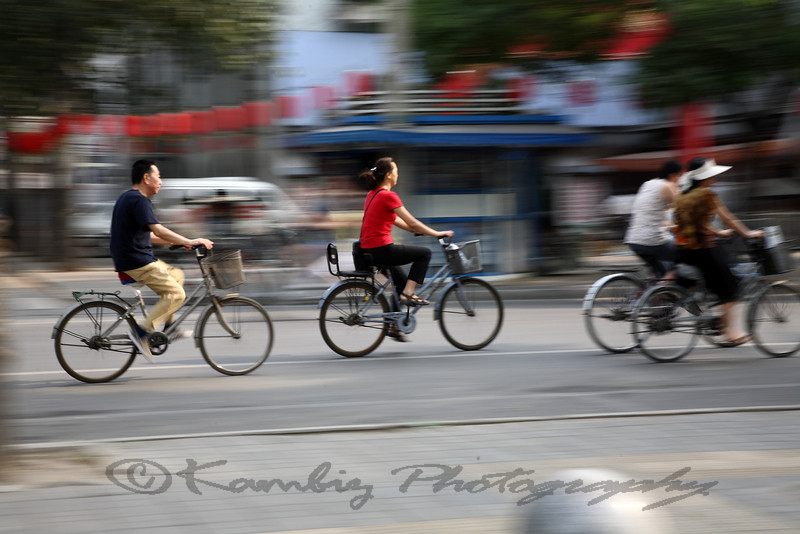 People riding bicycles in china