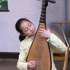 Young Chinese Girl Playing a Chinese Instrument