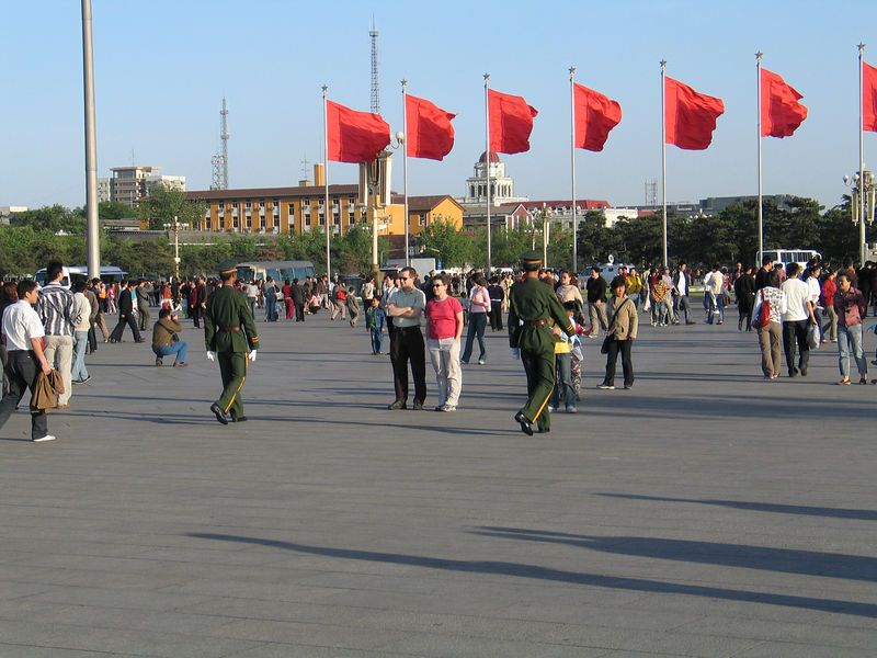Ed and Lisa flaned by soliers in Tienamen Square.