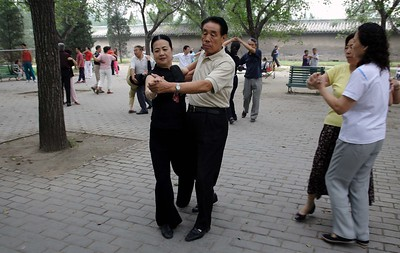 The Temple of Heaven: OK, this needs a bit of explanation. We visited the temple in the morning. To get there, you walk through the surrounding park where you will find all manner of activity going on: ballroom dancing, music groups (mostly traditional), singers, card schools, tai chi, and a number of other games and exercises we couldn't put a name to. People were there, in public, just doing their thing and having a good time.  It is well worth a few hours just wandering around.