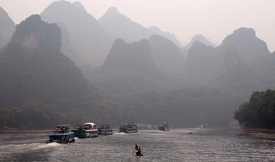 Li River cruise, China: We chose to take a river cruise to Yangshou from Guilin,  which is the usual way people do it. Whether you do the return trip to Guilin (boat then bus) or not, you still pay for it. The cruise was not at all as I had imagined it. Firstly, you joined a day tour. You are herded onto to these cruisers, and they all, more or less, leave together. So you head off down the river in a convoy. The cruise is about four or five hours long, during which time you are served lunch, which was quite good. The landscape, as you can, is spectacular. So, it well worthing doing.