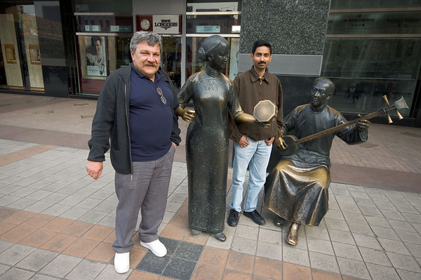 Coworkers Slawek and Krishna wonder at the artwork along the Wangfujing shopping district.