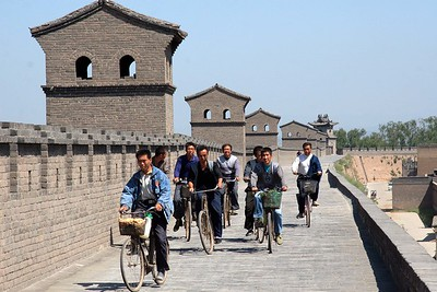 I was walking along the top of the city walls, when, seemingly out of nowhere this group of cyclists were happily peddling towards me. They gave a whoop and passed by. I think they were workers who were repairing sections of the wall. It was amusing, nonetheless.