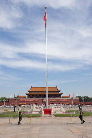 Tiananmen Square - National Flag with entrance to the Forbidden City in the background