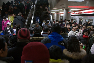 People everywhere!   Most good natured about the crowds.  This is the Beijing subway system.