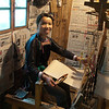 Weaving on the loom in the front (?only) room.(Yintan village)