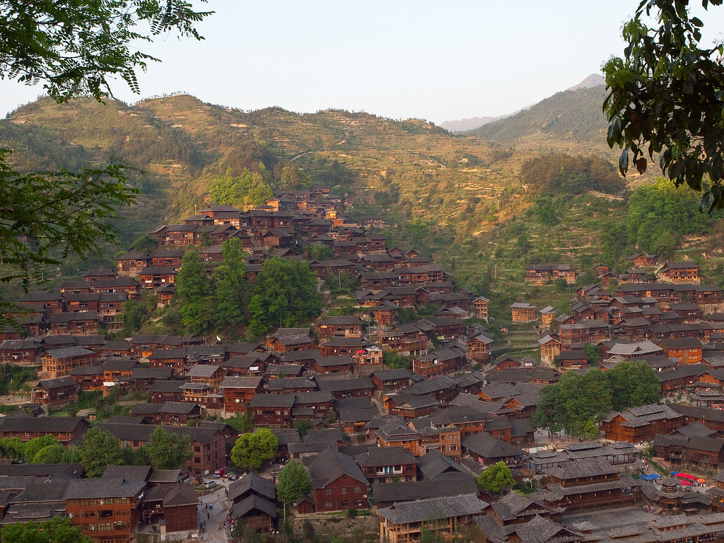 After several days travelling we reached Xijiang (E. on the map). This all wooden town built on two hills is changing fast; with a new main road recently built it is no longer cut off from the tourist route, as a centre for the Miao culture it is bound to become a major attraction. (many more pictures in > China 2010 > The odd landscape)