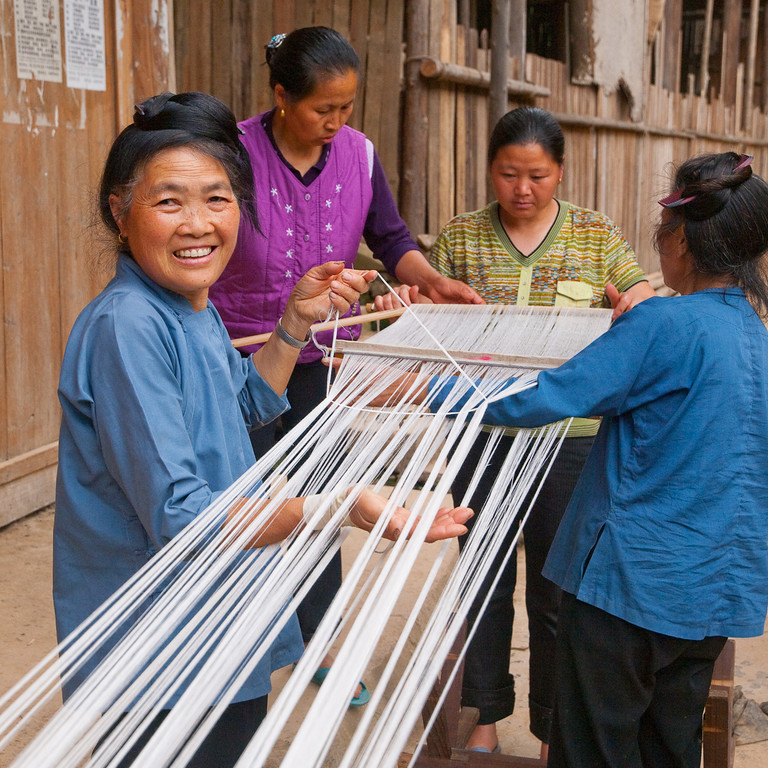 """Cloth: it has to start somewhere…….  and here in a village beside the Duliu Jiang (river) the ladies were winding the thread ready for the loom (see more in > China 2010 > Guizhou Cloth  or <a href=""""http://agbr.smugmug.com/Travel/China-2010/Guizhou-Cloth/12367916_YZeLb#887613212_KuW5o"""">http://agbr.smugmug.com/Travel/China-2010/Guizhou-Cloth/12367916_YZeLb#887613212_KuW5o</a>)"""