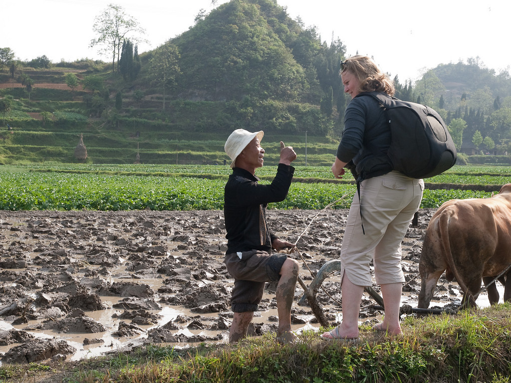Surprisingly, potato is a major crop in the region east of Guyang. The people in the fields, rice terraces and villages are really friendly and welcoming, I was glad to be in such a small group, and visiting an area not frequented by tourists. <br /> Jules gets the thumbs up from this farmer for her picture of him but declines the offer to have a go at ploughing!
