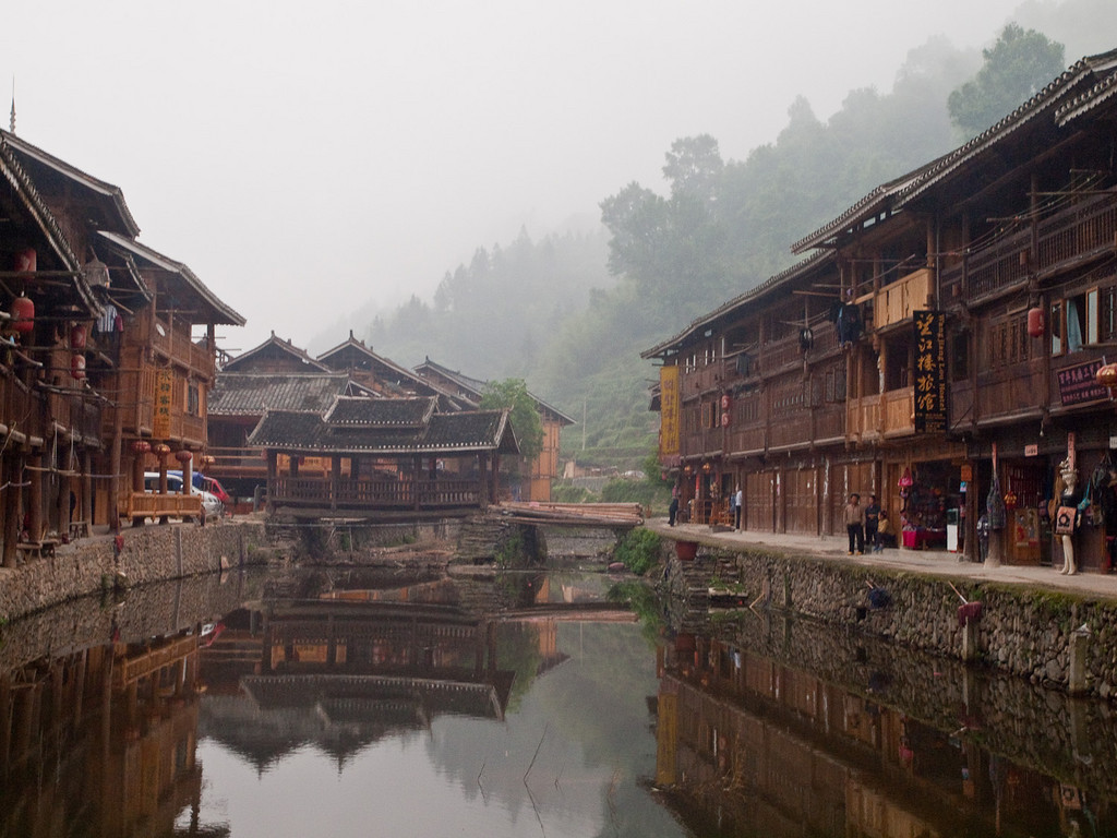 A misty morning in Zhaoxing. Our guesthouse is the last building on the right by the log bridge.... OOps I left my windows open!