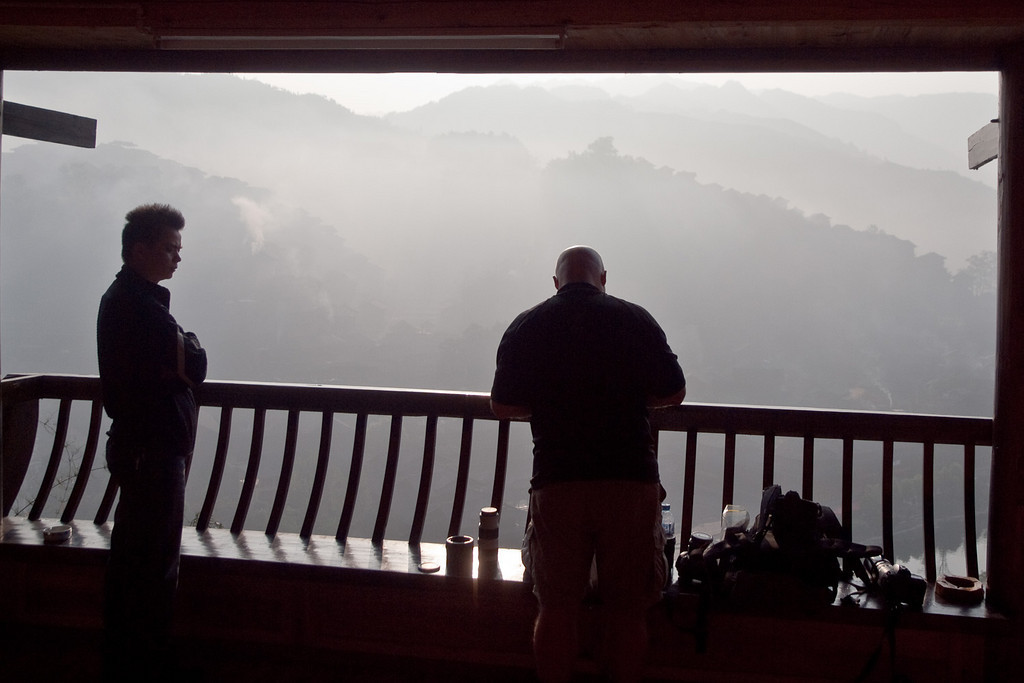 Early morning mist in Xijiang after overnight rain. <br /> We were staying in a guesthouse on the hill to the west of the town, so this was our breakfast view with Mr Li and Ewen.