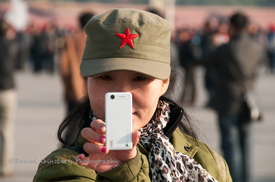 Woman taking a picture, apparently of me, in Tiananmen Square.