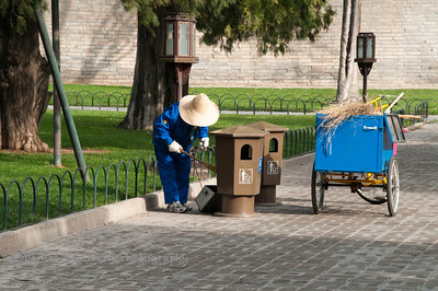 Worker cleaning walkway at the Temple of Heaven.