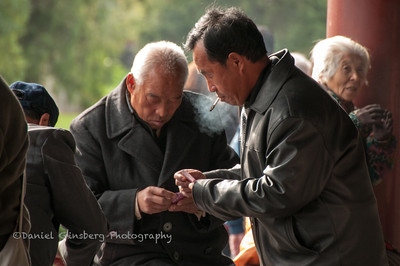 Playing cards at the Temple of Heaven.