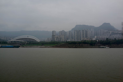 A stadium for new city along the Yangtze.  Possibly Zhongxian, Shib ao zhai or Wanxian (somewhere east of Chongqing).