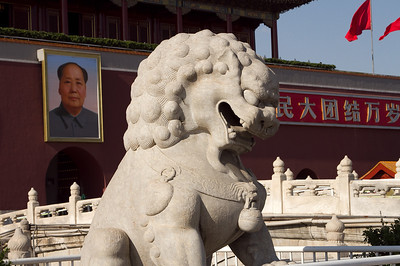 Beijing - Lion statue and portrait of Chairman Mao, Tiananman Square.