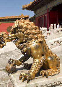 Beijing - Forbidden City - Male Lion (has a ball under it's paw).