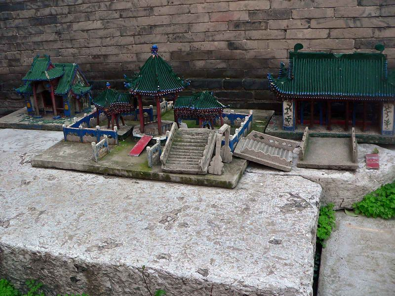 This is a miniture mosque sitting on the side of a wall, I'm assuming kids play with it.