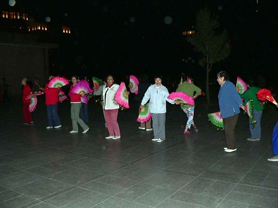 People go to the parks at night throughout China to dance and roller skate and meet friends.