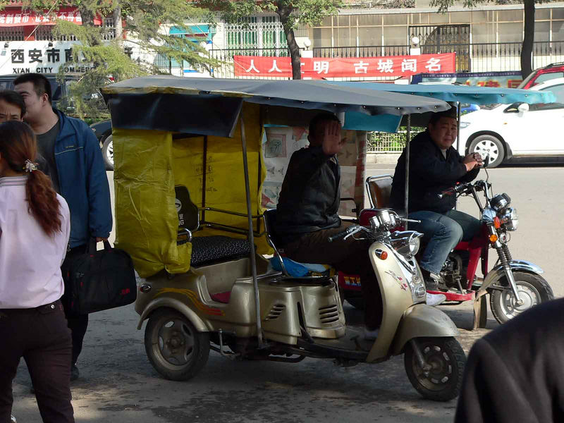 Shy taxi drivers in Muslim area of Xi'an China