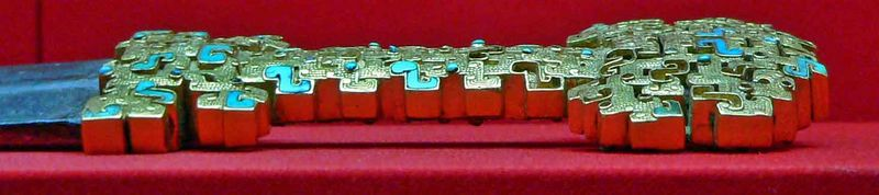 Ornate handle of a sword found with the warriors