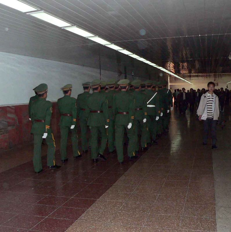 Guards marching in the pedestrian underpass under Tiananmen Square.
