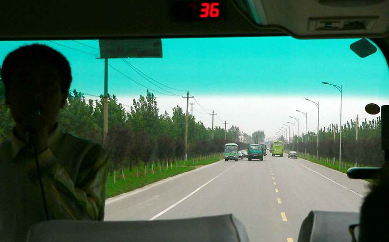 Here we are passing a car and driving TOWARDS those big trucks heading for us!! YIKES!!! There are NO RULES in China when it comes to driving.