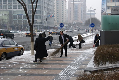 Sweeping snow with Chinese twig broom