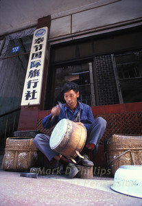 A man creates a pot in the marketplace of Fengjie, China, in 1995