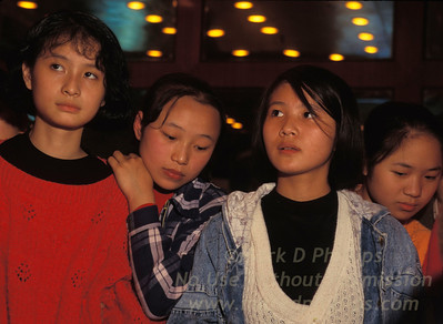 Teens gather in Fengjie, China, to meet Jay Cochrane before the Great China Skywalk in 1995