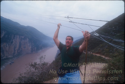 Steve Sless under Jay's wire in Qutang Gorge in Fengjie, China