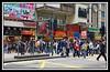 Masses of people crossing street...