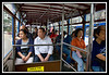 Passengers on a double deck trolley...